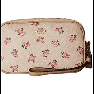 Coach crossbody clutch with floral bloom print.